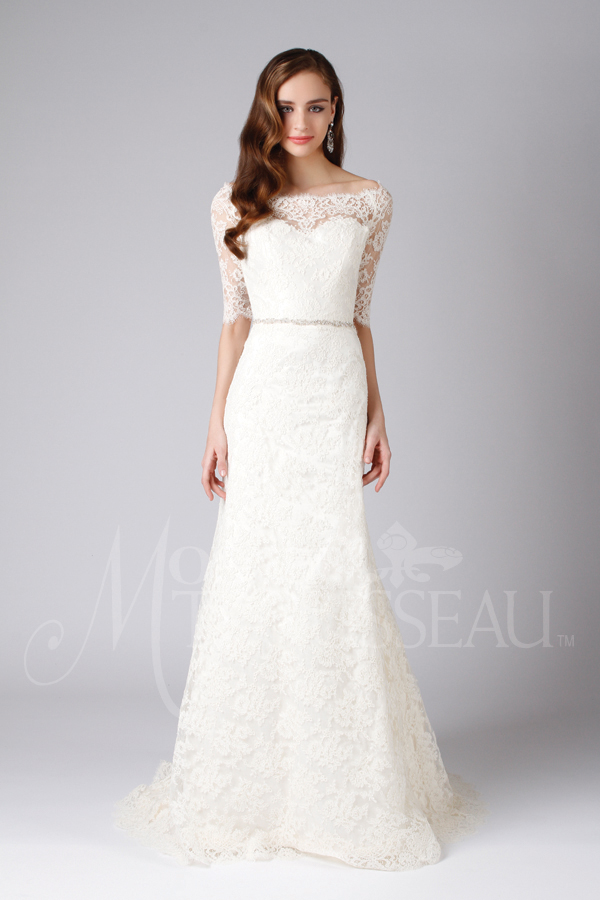 Fitted, lace wedding dress features off-the-shoulder neckline and A-line skirt with beaded belt by Modern Trousseau. Made in the USA by Modern Trousseau.