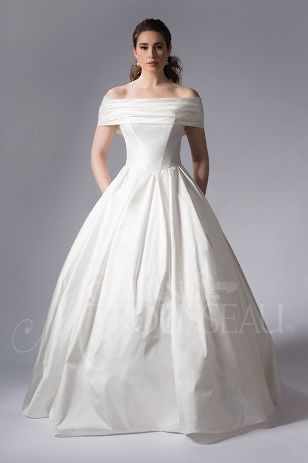 Strapless ballgown wedding dress features a drop waist and detachable off-the-shoulder wrap by Modern Trousseau. Made in the USA by Modern Trousseau.
