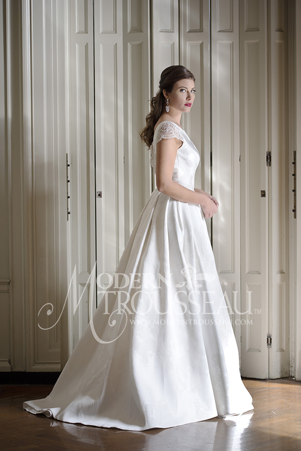 Cap sleeve ballgown wedding dress that features a Bateau Neckline and Scoop Back by Modern Trousseau. Made in the USA by Modern Trousseau.