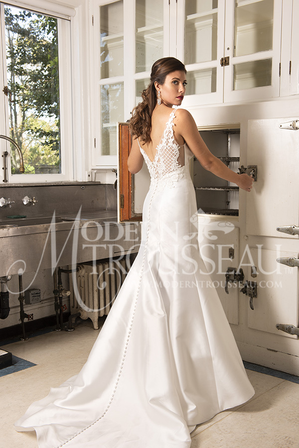 Fit-to-Flare wedding dress features V-neck front and back with intricate detailed straps by Modern Trousseau. Made in the USA by Modern Trousseau.