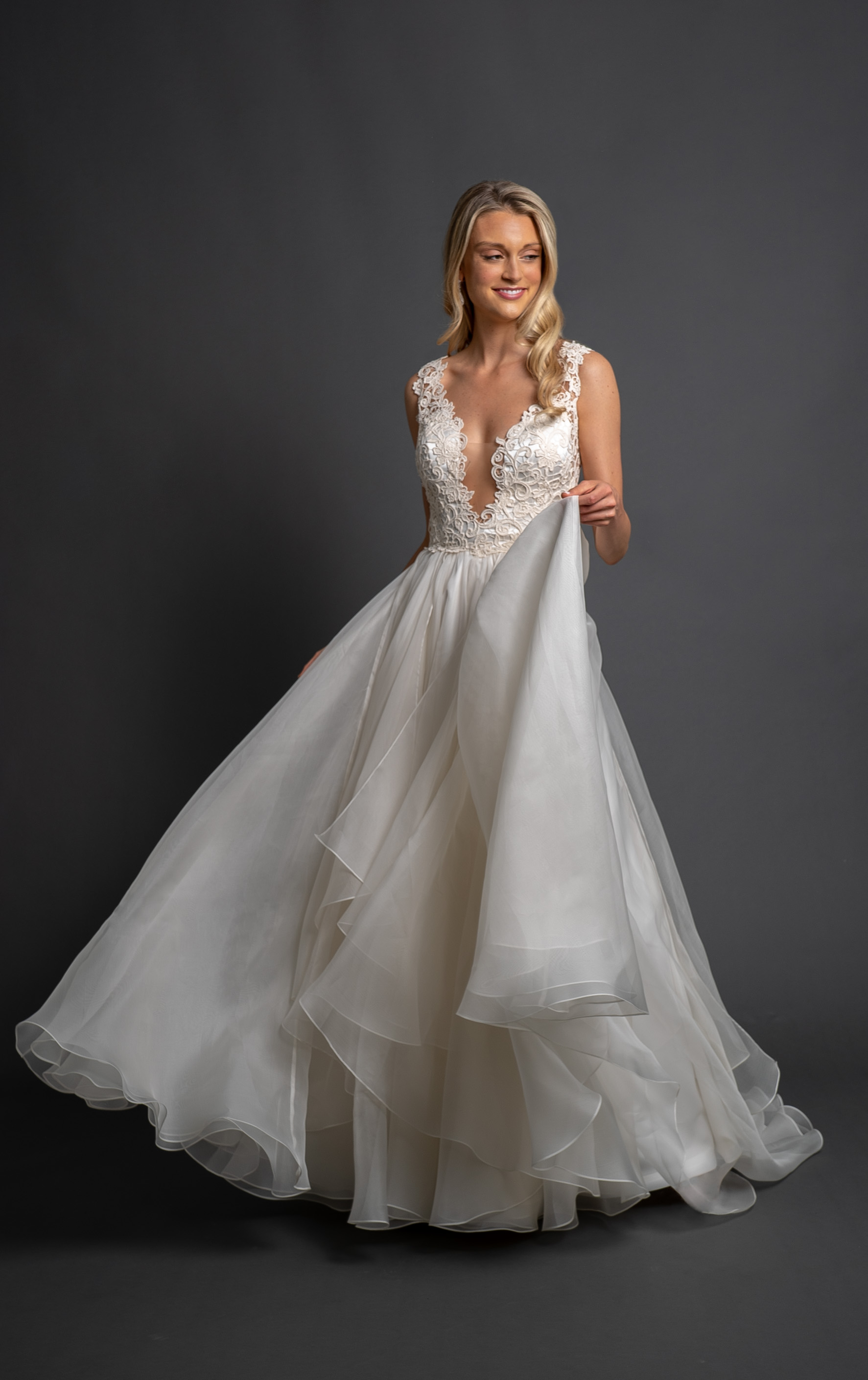 Sleeveless Wedding Dress with Fitted Deep V Bodice and A-line Skirt by Modern Trousseau. Made in the USA by Modern Trousseau.