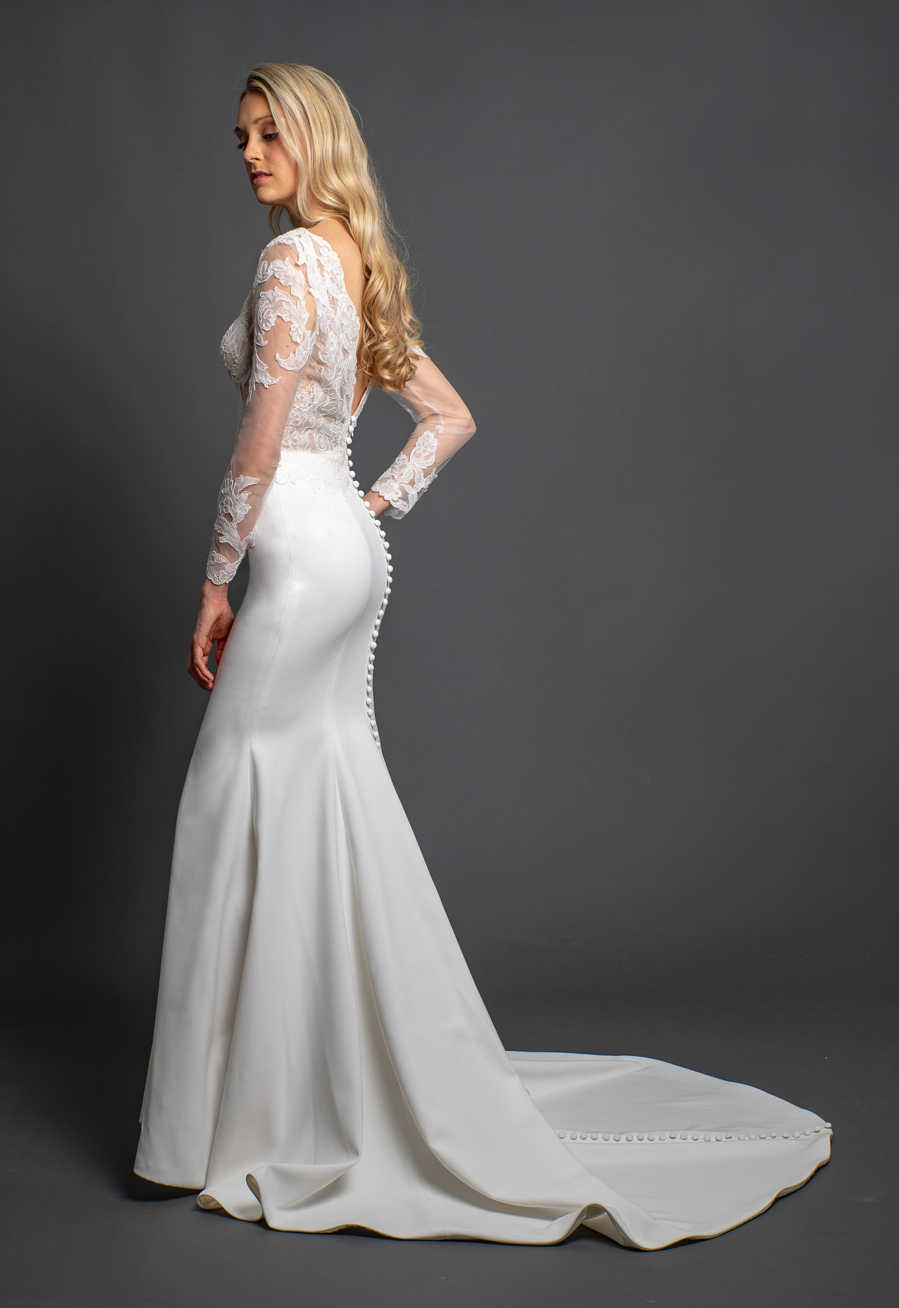 Sleeveless V-neckline Fitted Lace Wedding Dress by Modern Trousseau. Made in the USA by Modern Trousseau.