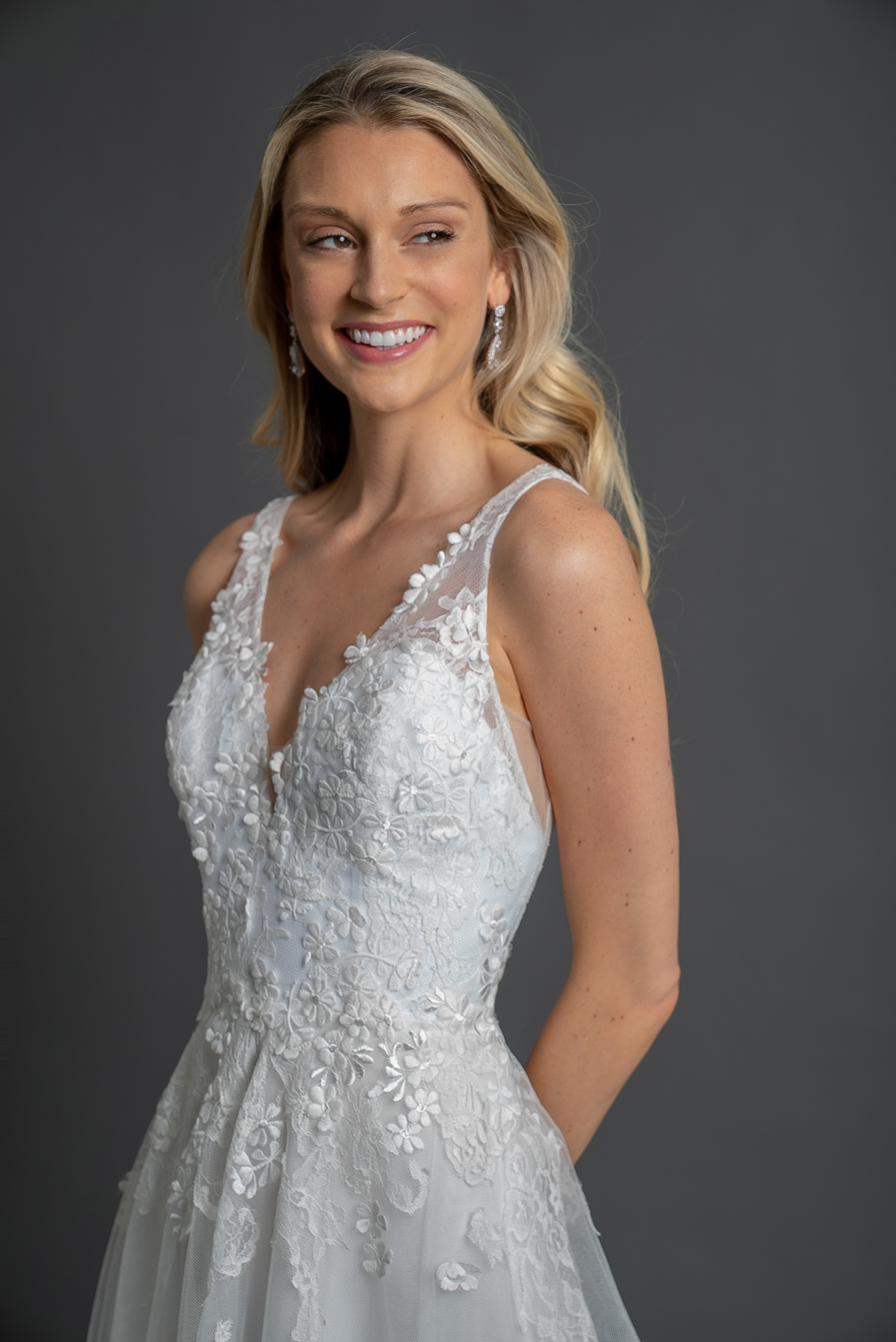Sleeveless V-neckline embroidered wedding dress with A-line skirt by Modern Trousseau. Made in the USA by Modern Trousseau.