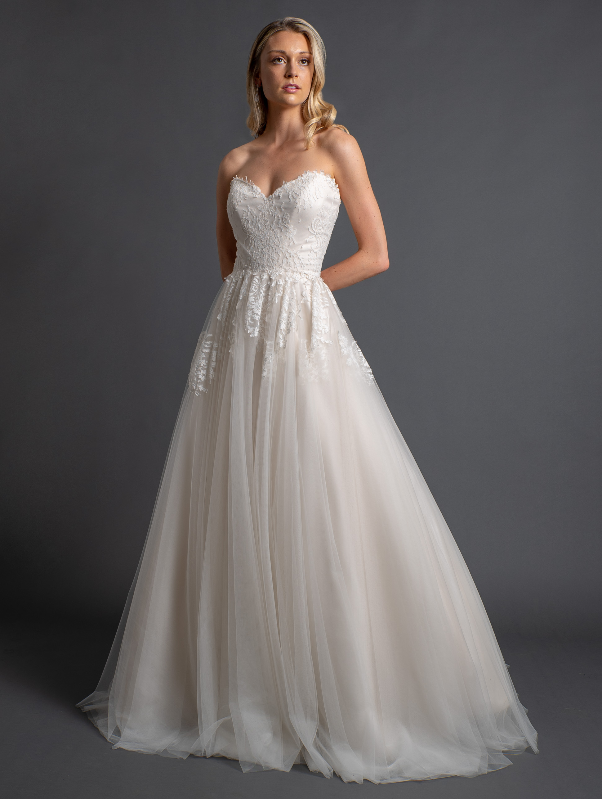 Strapless Lace Wedding Dress with Full A-line Skirt by Modern Trousseau. Made in the USA by Modern Trousseau.
