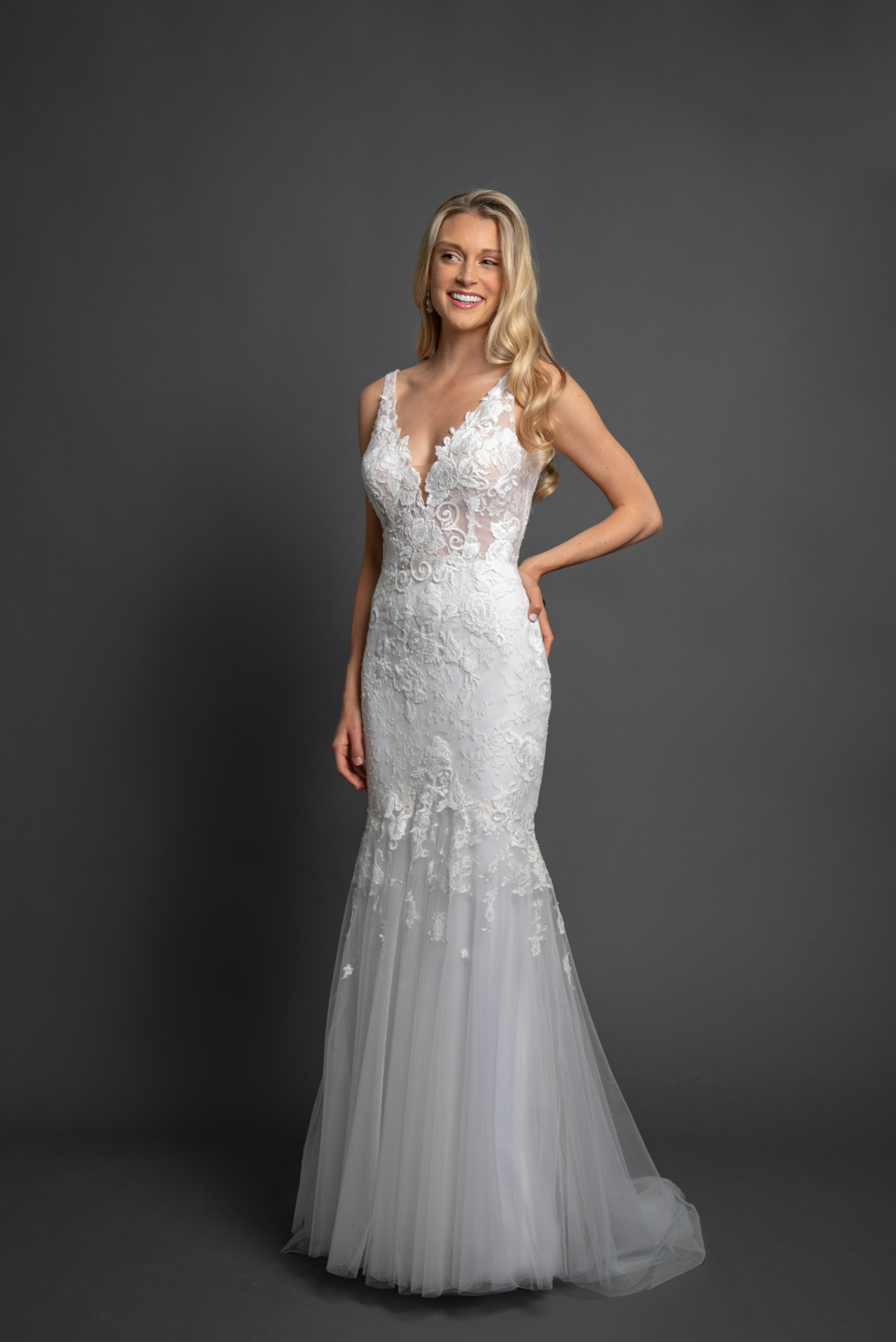 Sleeveless Fit to Flare Embroidered Wedding Dress by Modern Trousseau. Made in the USA by Modern Trousseau.