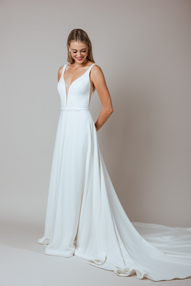 Sleeveless Deep-V Fitted Wedding Dress with Embroidered Belt by Modern Trousseau. Made in the USA by Modern Trousseau.