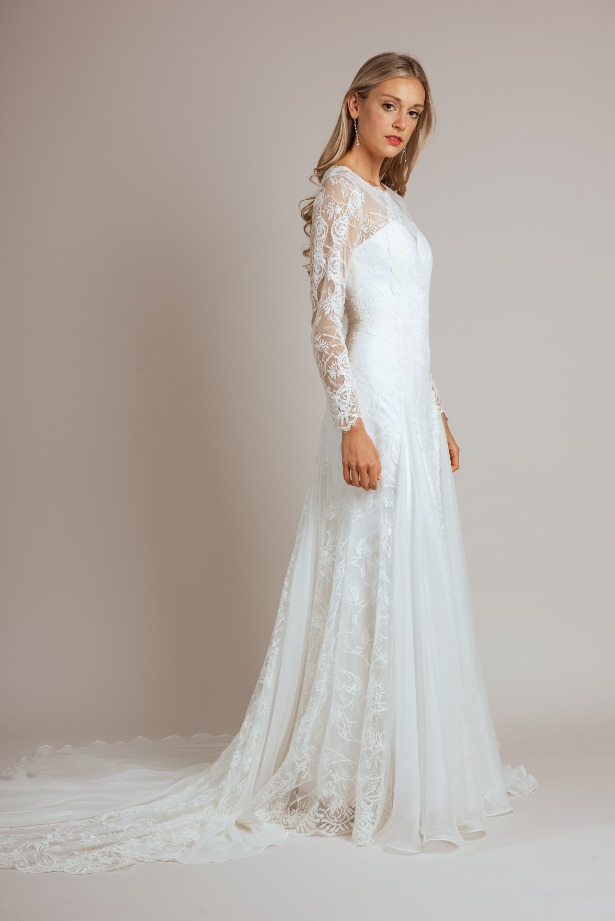 Long-Sleeved Full Lace Wedding Dress with Full Train by Modern Trousseau. Made in the USA by Modern Trousseau.
