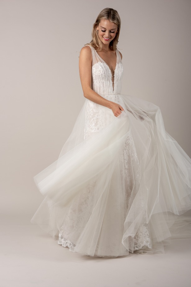 Sleeveless Lace Wedding Dress with Sheer Overlay by Modern Trousseau. Made in the USA by Modern Trousseau.