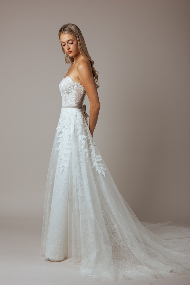 Strapless Fitted Lace Wedding Dress with Velvet Belt by Modern Trousseau. Made in the USA by Modern Trousseau.