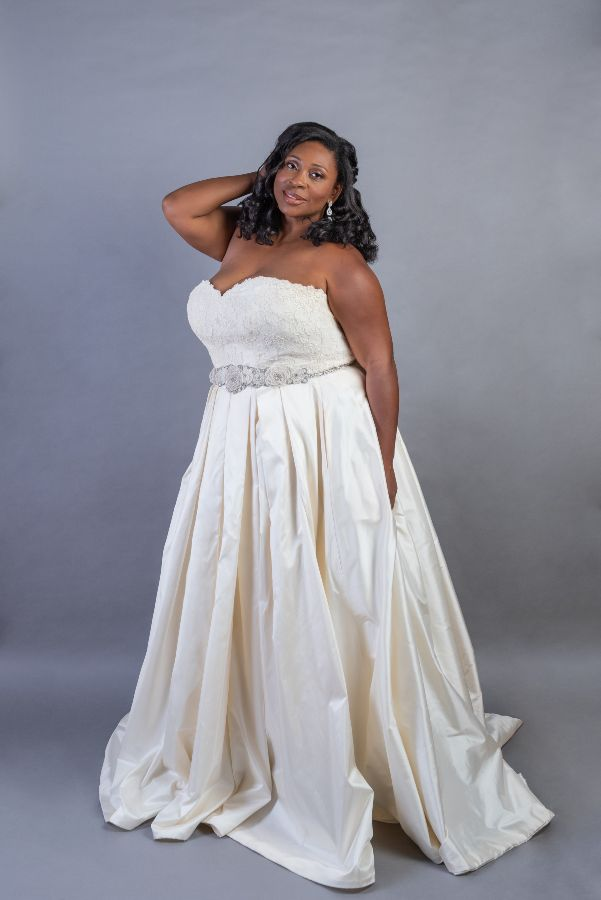 Strapless plus size bride in wearing gown with lace top
