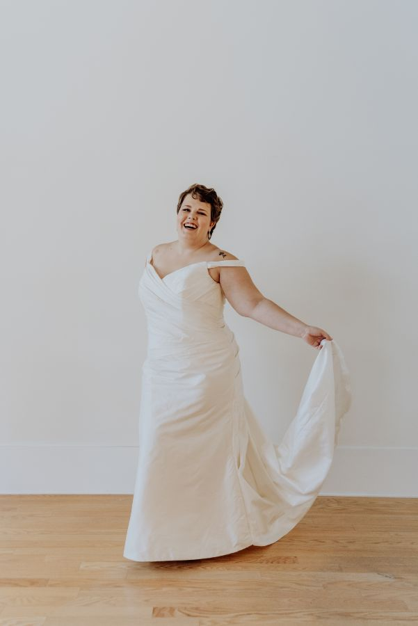 Bride dancing while holding her train