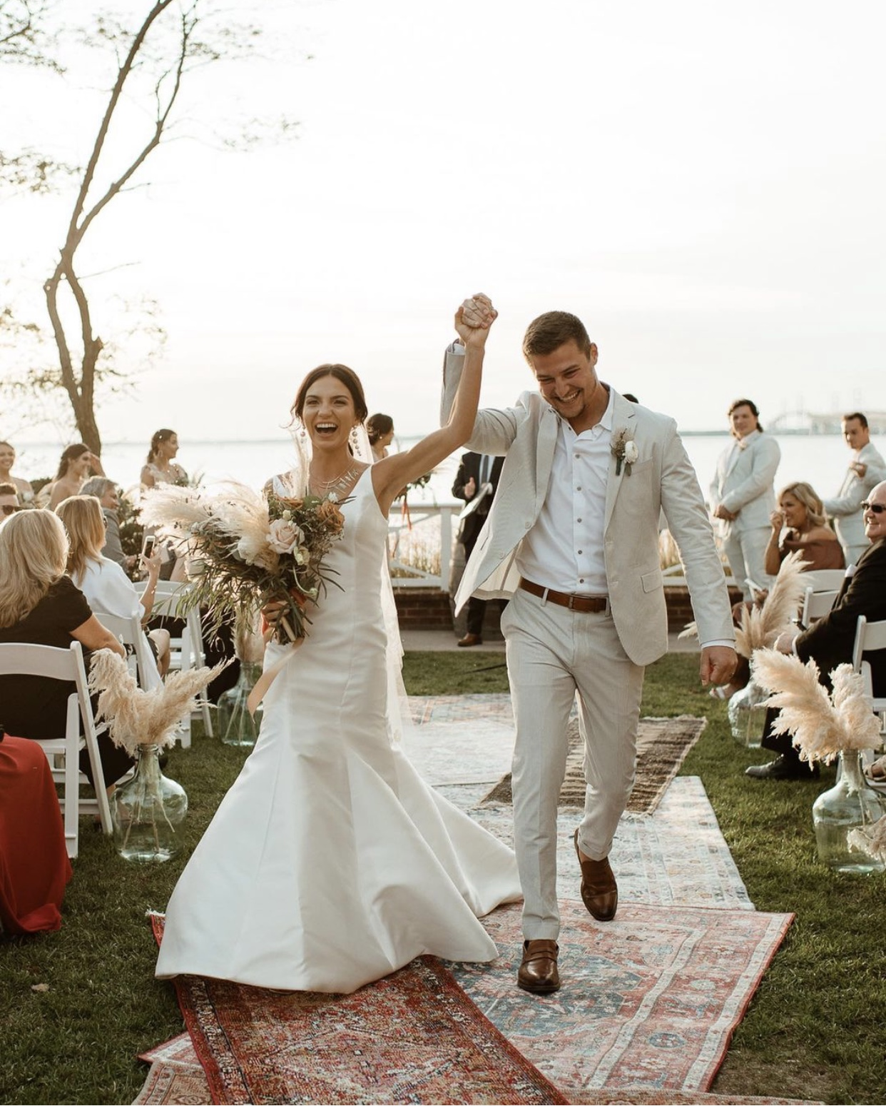 Bride wearing simple. elegant gown for her Chesapeake Bay wedding
